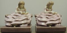 1930 Pair of Rookwood Pottery Hand-Painted Young Woman Reading Bookends Designed by John Wesley Pullman by gallery332 on Etsy https://www.etsy.com/listing/211135977/1930-pair-of-rookwood-pottery-hand