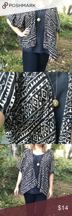 Tribal print semi-sheer flowy cardigan Black & beige Tribal print cardigan , loose flowy fit. Great condition - size large. Thank you! Cecico Tops Camisoles