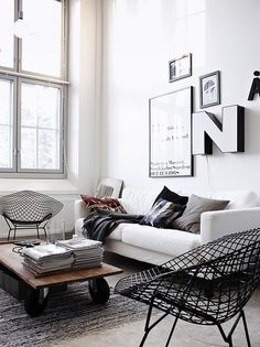 moody hues by the style files, via Flickr black white and grey living room industrial coffee table black bertoia chairs
