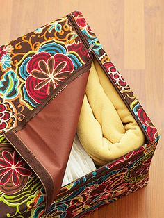 Canvas Storage Boxes:  Zippered floral canvas boxes pack extra pillows, blankets, and other bed linens away. They're stylish, simple to use, and stackable.