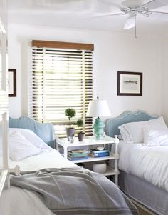 Guest Room-For the guest room, Bates added cotton slipcovers to twin headboards from her own childhood.    Read more: Beach Cottage Style - Decor For Beach Cottage - Country Living