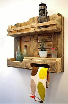Here is another nice and rustic kitchen shelf made out of pallet wood. You can place your spice boxes and there kitchen accessories. It can serve multiple purposes as the provision of a towel hanger is also there for added utility. It has more rural and natural look.