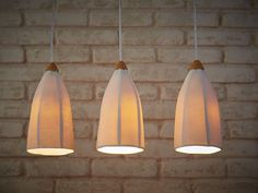 These pendant lights are handmade from slabs of porcelain. The texture of the horizontal lines creates a beautiful effect when the light is Hanging Chandelier, Hanging Pendants, Chandelier Pendant Lights, Modern Chandelier, Hanging Lights, Ceiling Chandelier, Kitchen Pendant Lighting, Bar Lighting, Modern Lighting
