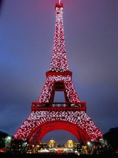 Climb the Eiffel Tower during the holiday season.