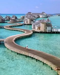 The Maldives are home to some of the most incredible over water villas. These particular ones are all connected by a winding path #maldives #traveldestinations