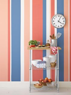 """I love these vertical stripes! The varying widths and colors help draw your eye upward so the room feels instantly taller—great if you have low ceilings."" Paint these stripes on an entire wall or just part of it—they're striking either way. Paint: (from left) Delicate White, Rose Pomander, Pomegranate, and Stormy Ridge, all by Pittsburgh Paints"
