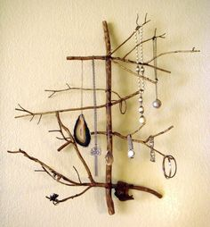DIY. jewlery organizer just go get some sticks and twigs from the back yard. Spice it up by wrapping them together with colorful string
