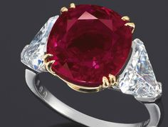 "#assetoftheday Harry Winston Burmese Ruby and Diamond Ring. One of the ten most expensive rubies sold at auction at nearly $4 million, this cushion-cut ruby weighs nearly 9 carats and has what is known as a ""pigeon blood"" hue."