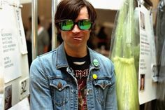 Ryan Adams, from Spin Magazine. Groovy sunglasses, denim, Iron Maiden tee atop a ringer tee, and a lollipop in mouth.