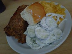 Huge slice of meatloaf, cucumber-sour cream salad, scalloped potatoes and a roll at the Hy-Vee Food Store deli on Rockingham Road in Davenport, Iowa.