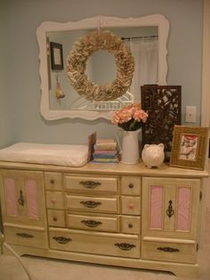 I love, love, love this nursery...this dresser/changing table can grow with the baby!!!