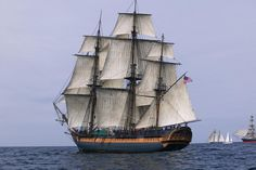 HMS Surprise Sailing Ship at Sea under full sail with tall ships in the background. Description from pinterest.com. I searched for this on bing.com/images