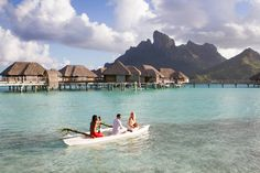 Getting married at the sunset time at the Four Seasons Resort Bora Bora