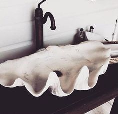 We have found the perfect sink for you bathroom. Live the mermaid life with this clam shell sink. Bring your love of the ocean into your home.