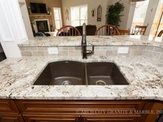 Café' Brown Blanco Silgranit undermount sink with white granite countertops