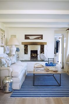 Paolo Moschino has conjured up the perfect, gently nautical scheme for this Cornish cottage living room. The blue and white striped rug anchors the scheme.  (houseandgarden.co.uk)
