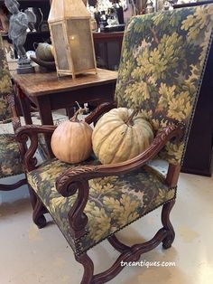 Old French chairs covered in a tapestry fabric