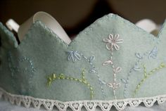 An embroidered crown! Perfect for any magical little souls birthday or dress up box! This crown is made of the softest felt. I hand embroidered