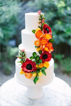 white wedding cake with bold flowers @weddingchicks