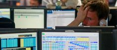 Traders from BGC, a global brokerage company in London's Canary Wharf financial…