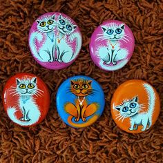 A variety of cats painted on stone!