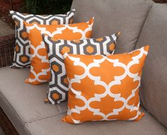 THESE PILLOWS ARE MADE TO ORDER. Please allow 4 business days for processing your order.    This listing is for a total of 4 (FOUR) pillows. Fabric Name - FYNN  Color - CINNAMON  Colors : This pillow depicts a cream quatrefoil design against a mandarin orange background    ( 2 ) Throw - 16 x 16    Fabric Name - MAGNA  Color - CINNAMON  Colors : This pillow depicts a modern design in cream, gray and mandarin orange    SAME FABRIC BOTH SIDES    The pillow is filled with a high quality fiber…