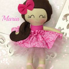 Pretty Maria dolls with two skirts.....top skirt has velcro closure and tulle underskirt has elastic waistband. She is one pretty girl!