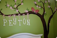 Hand painted cherry blossom tree tutorial for a babies room by googiemooma. She uses a stamp for the cherry blossoms and they looks great.