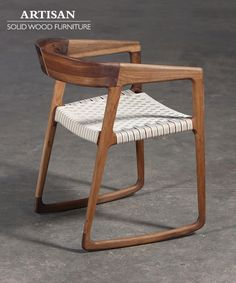 Wooden rocking chair by Artisan.
