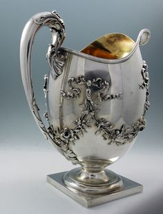 Whiting sterling silver antique pitcher with applied floral swags
