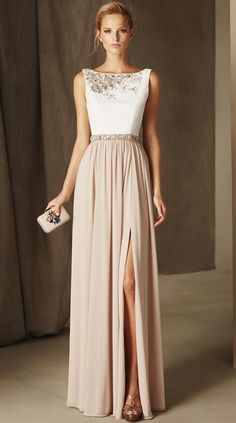 Chic two tone bridesmaid dress with bateau neckline and jewel embellished detail; Featured Dress: Pronovias