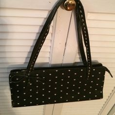 VINTAGE hand bag. Vintage handbag Black w/ white tiny hearts. The details in this bag are what make it special. Cute lil bow, stitching on straps, petals on bottom of bag. Inside bag is divided and has side zipper Bags Shoulder Bags