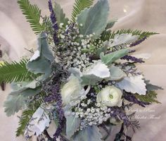 Rustic Romance Bridesmaids bouquet made with wildflowers: Lavender, Caspia, Gypsophilia, Austrialian Palm, Dusty Miller and White Ranunculus all ties together with burlap and twine. Designed by Petals to Pines/101 Market Floral in Otsego, MN Karen & Matt: 6.9.12