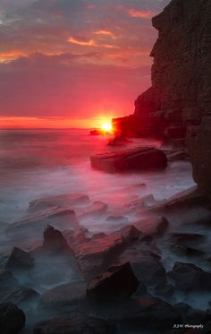 "♂ Ocean rock sunset ""Cliff faced man"" by Adam Walters"