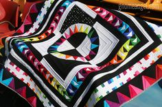 She's a Rainbow quilt by Gnome Angel. Gorgeous!