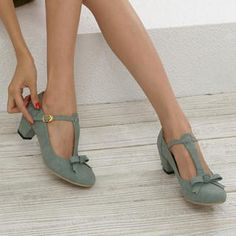 T strap shoes with a bow on the toe.