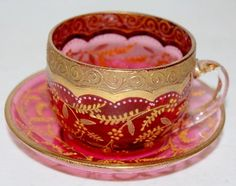 Moser Decorated 4:00 Tea Cup & Saucer, cranberry with gold vining floral motif.
