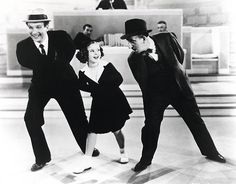 Shirley Temple with Jimmy Durante and El Brendel in Little Miss Broadway, 1938.  My great grand uncle is El Brendel.