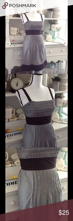 """🎀 Guess Jeans dress Black and white stripes, coordinating solid black waist, straps, and hem. Elastic bodice, pleated skirt top, with side zipper for easy on and off. Skirt is fully lined. Top of strap to hem is about 36"""". Bust is about 28""""' but it stretches a lot. 100% cotton! machine wash warm. Good used condition. Guess Jeans Dresses"""