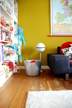 white room and one wall of bright colour.