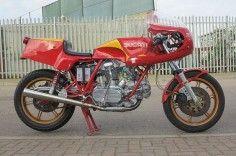 Ducati 748 - faster in red. Motographite.