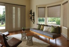 Solar shades have come a long way from boring black.  Available in roller shade and sliding panels with numerous valance options to create a cohesive look throughout your home.