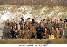 BUDAPEST, HUNGARY - MAR 24: Japanese extras take souvenir photos of themselves between shooting on the set of 47 Ronin,  a new epic 3D martial arts film starring Keanu Reeves in Budapest, Hungary, on Thursday, March 24, 2011. - stock photo