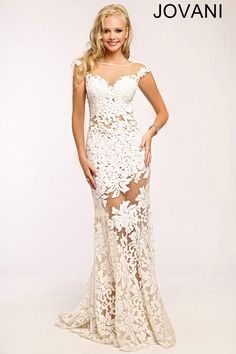 White Prom Dress by Jovani- This cap sleeve sheath gown is perfect for any glamorous event. View more prom dresses by Jovani.