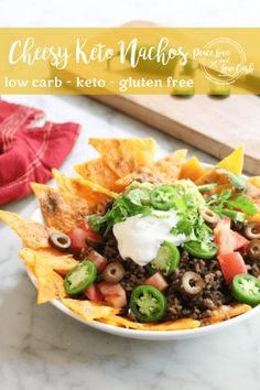 Light and crispy cheese chips, piled high with all of your favorite nacho toppings. And people say keto is hard? Not with Cheesy Keto Nachos, it isn't!