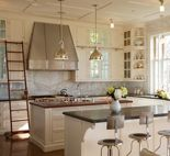 White kitchen with metal hood