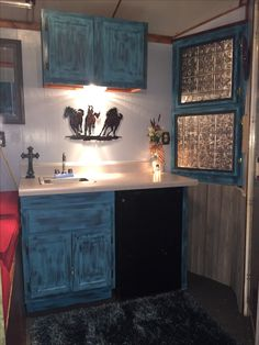 Like the turquoise cabinets More