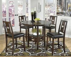 """Ashley Logan 5 piece counter-height dinette set. Table size: 42"""" round. Only $539."""