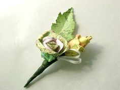 Vintage map atlas paper rose and bud boutonniere for weddings and proms. $12.50, via Etsy.