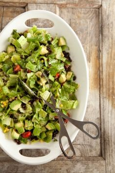 Southwestern Avocado Black Bean Salad: 1/2 cup freshly chopped cilantro leaves   1/4 cup extra-virgin olive oil   2 tablespoons freshly squeezed lime juice   2 or 3 dashes hot sauce (recommended: Tabasco)   4 cups chopped romaine lettuce   2 avocados, peeled and diced   2 cups fresh or frozen corn kernels, thawed and drained   2 (15-ounce) cans black beans, rinsed and drained   1 cup chopped cherry tomatoes   About 3/4 cup (3-ounces) grated pepper jack cheese   salt and ground black pepper